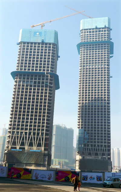 A pair of skyscrapers still under construction at the mega real estate project Huaguoyuan, or Flower and Fruit Garden, in Guiyang.